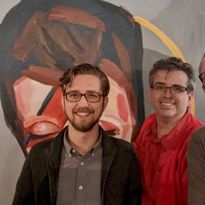 From left to right: gRegor Morrill, Jordan Yonts, Joe Crawford, and Simon Prickett standing in front of a painting of David Bowie