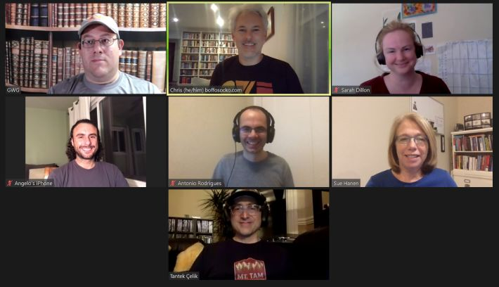 The smiling faces of a zoom capture of the nine people that attended HWC West.