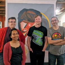 Joe, Suze, gRegor, and Simon in front of a painting of David Bowie as Ziggy Stardust
