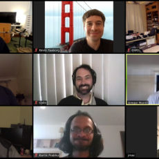 9 smiling faces in a Zoom meeting grid.